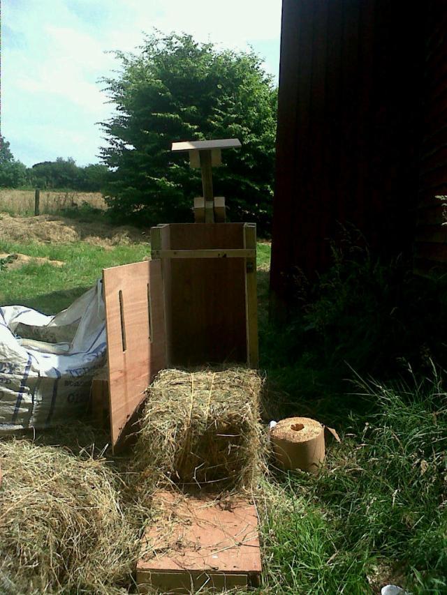 Baling up hay using a Hand Hay Baler