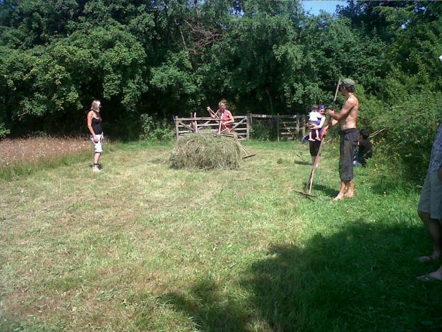 Having a go a stacking a hay rack